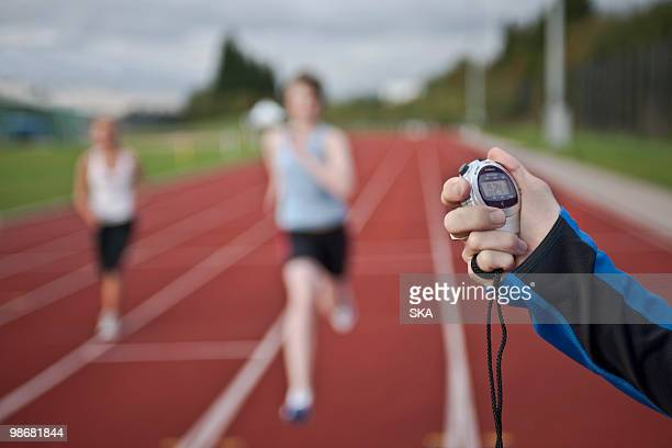 2 female athletes and stopwatch