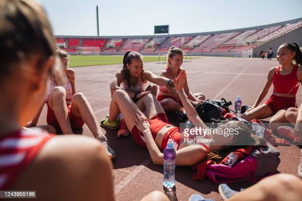 female athletes bonding after a hard hour of exercise - women's track stock pictures, royalty-free photos & images