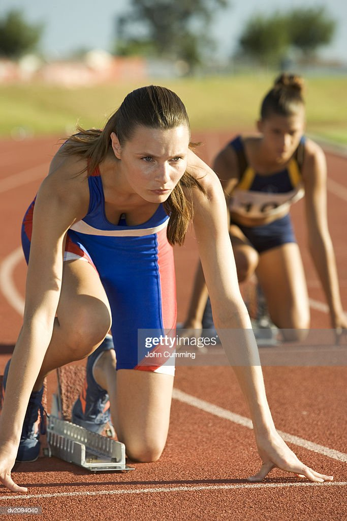 Female Athletes in Starting Position : Stock Photo