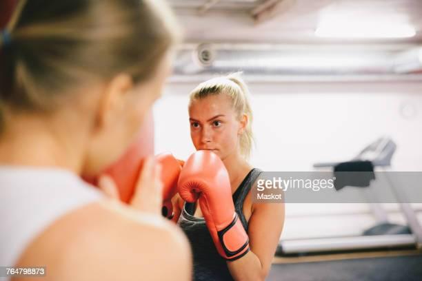 Female athletes practicing boxing at gym