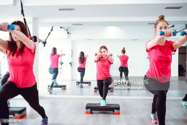 Female Athletes Working Out With Equipment In Gym