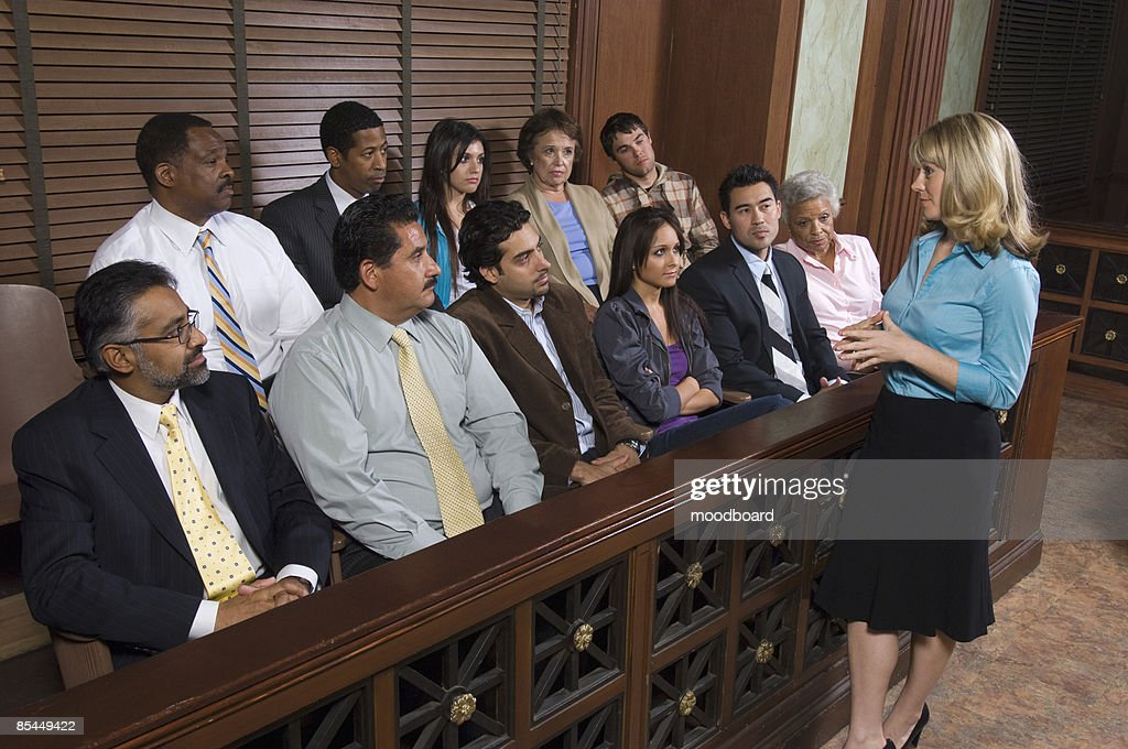 Female attorney addressing jury, elevated view : Stock Photo