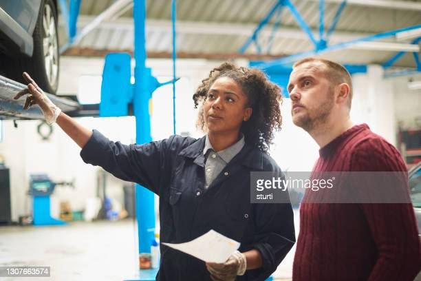female auto engineer with customer - glove stock pictures, royalty-free photos & images