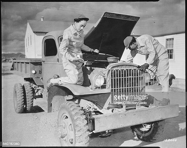 Female auxiliaries Ruth Wade and Lucille Mayo further demonstrate their ability to service trucks as taught them during the processing period at Fort...