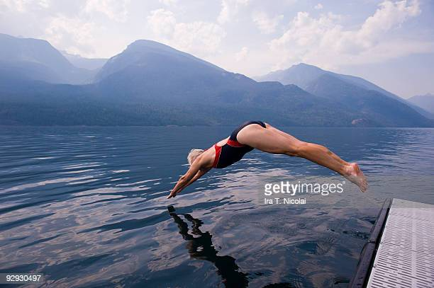 female babyboomer diving into lake