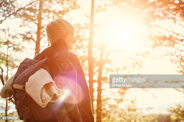 Female backpacker in forest