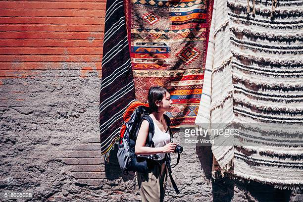 A female backpacker is waling around a local old market in Marrakesh
