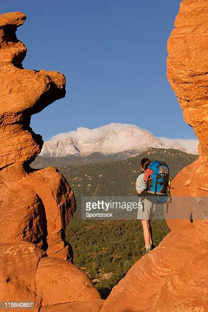 female backpacker looking at pike's peak - garden of the gods stock photos and pictures