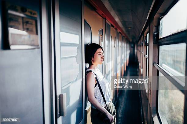 Female backpacker traveling on an old train