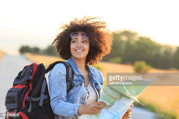 Female backpacker using a map