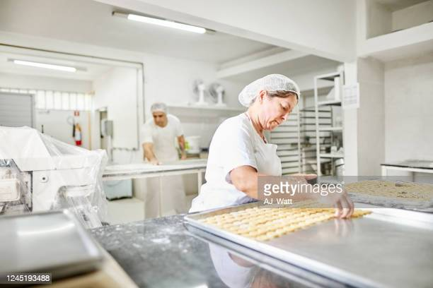 female baker at work - food and drink industry stock pictures, royalty-free photos & images