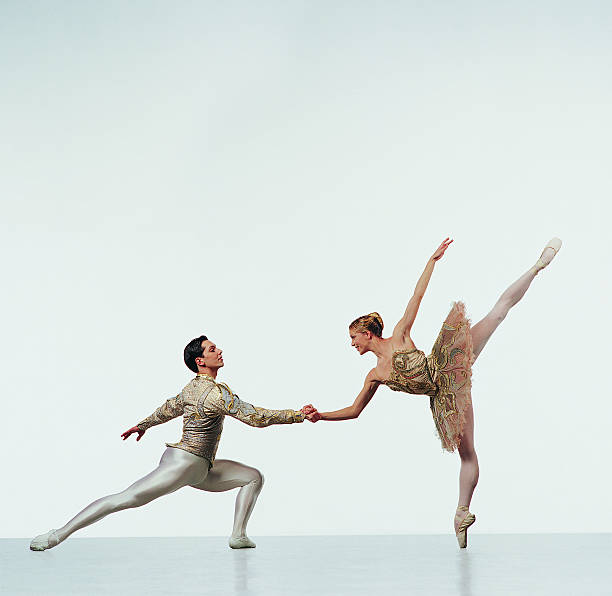 Female Ballerina Holding Hands With a Male Ballet Dancer