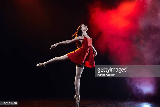 female ballerina in red dress - image stock pictures, royalty-free photos & images