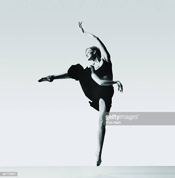 Female Ballerina Jumping on Tiptoe