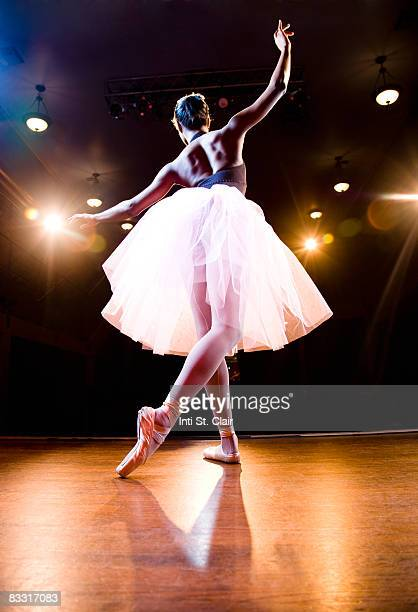 female ballerina on stage dancing - ballet dancer stock pictures, royalty-free photos & images