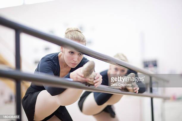 Female ballerinas practicing at the barre