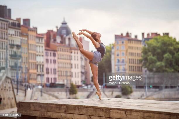 female ballet dancer dancing in the streets of lyon, france - ロシアバレエ団 ストックフォトと画像
