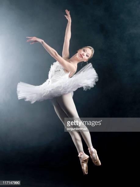 Female ballet dancer jumping in air