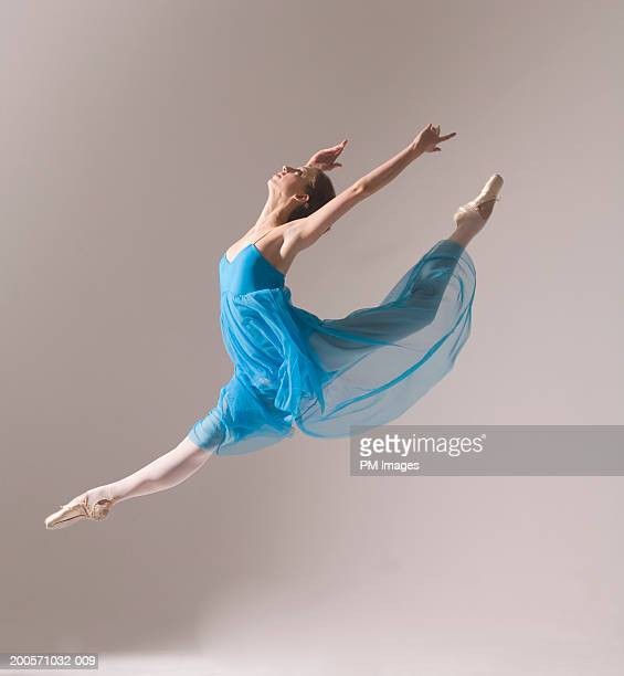 Female ballet dancer jumping in air