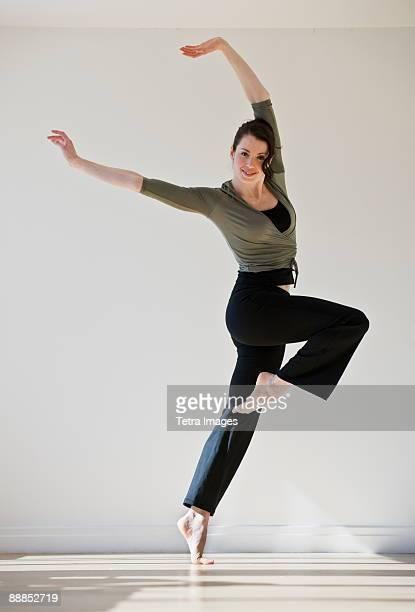 Female ballet dancer jumping, studio shot
