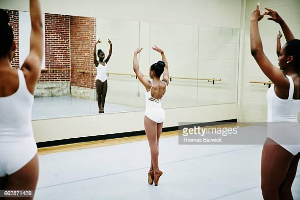 Female ballet dancers en point during rehearsal