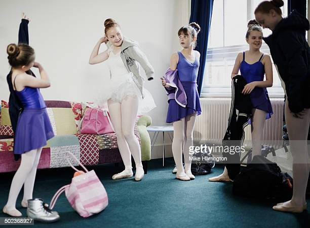 female ballet dancers getting changed after lesson - little girls in tights stock photos and pictures