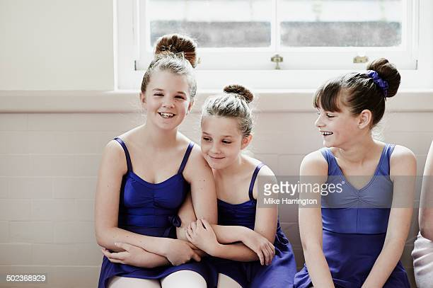 female ballet dancers laughing together - budding tween stock photos and pictures