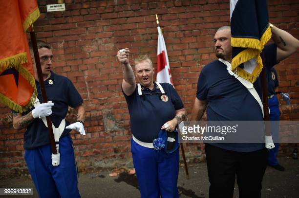 A female band member gives last minute instructions as the annual 12th of July Orange march and demonstration takes place on July 12 2018 in Belfast...