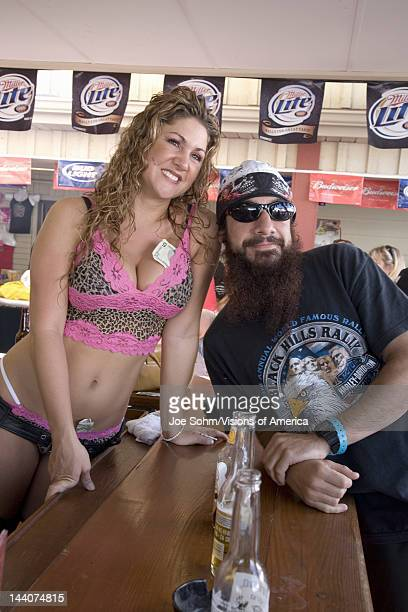 Female bar tender posing with motorcycle man at the 67th Annual Sturgis Motorcycle Rally Sturgis South Dakota August 612 2007