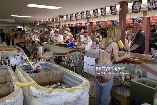 Female bar tender preparing drinks at the 67th Annual Sturgis Motorcycle Rally Sturgis South Dakota August 612 2007