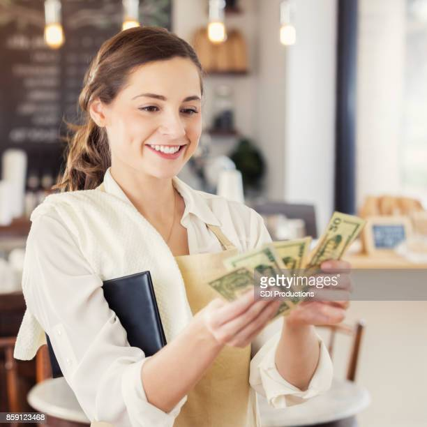 Female barista counts her tips