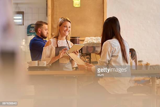 female barista taking order