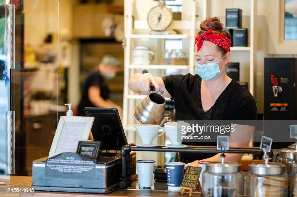 female barista wearing a protective face mask - opening event stock pictures, royalty-free photos & images