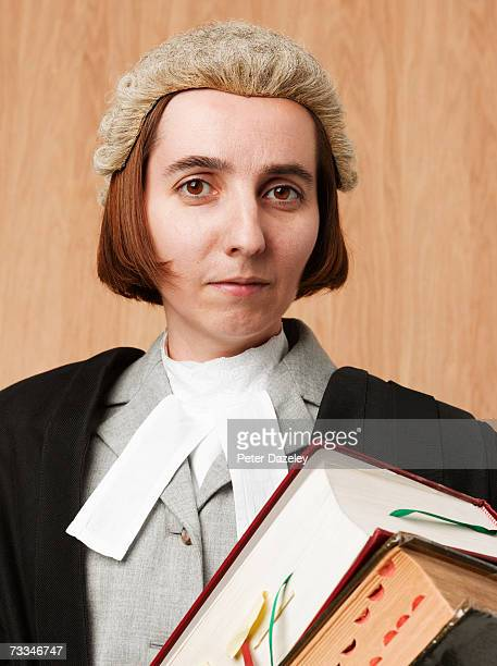 Female barrister holding books, portrait, close-up