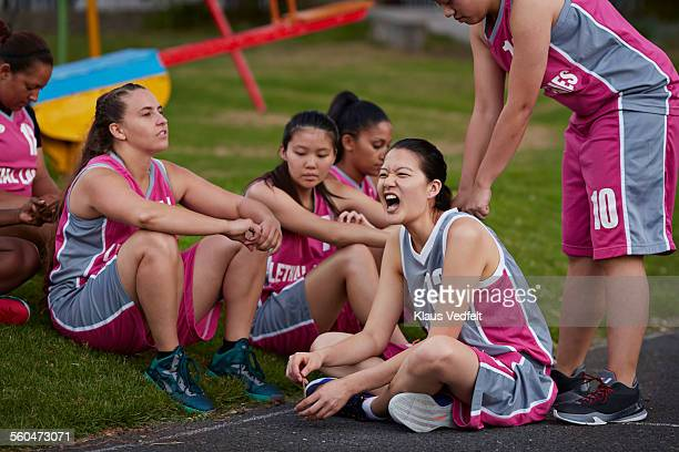 female basket player getting massage from teammate - rubbing stock photos and pictures