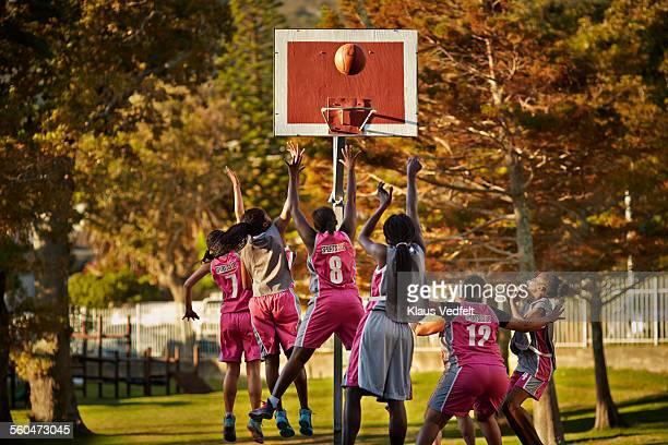 Female basket player scoring goal