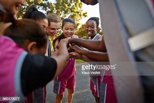 Female basket players doing ritual before game