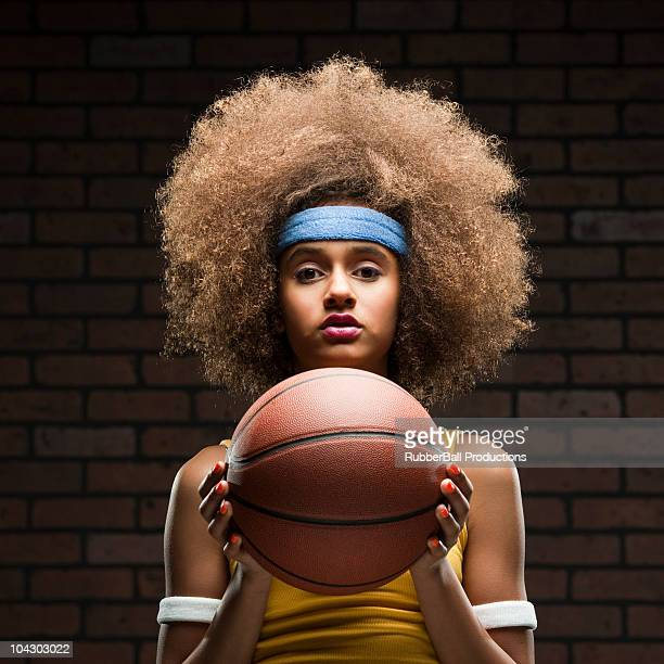 female basketball player about to shoot the ball