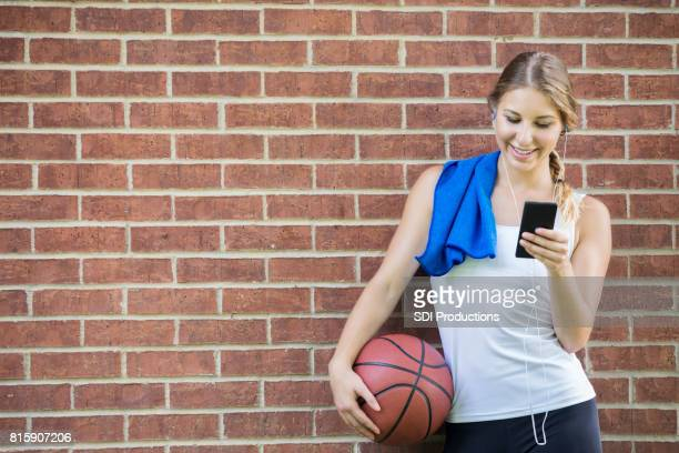 Female basketball player relaxes after game