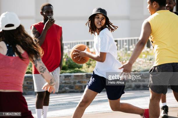 Female basketball player running and looking for a gap
