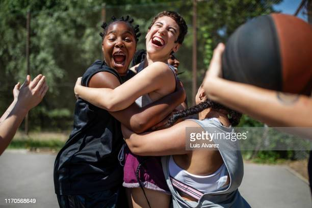 female basketball team celebrating a victory - sports stock-fotos und bilder