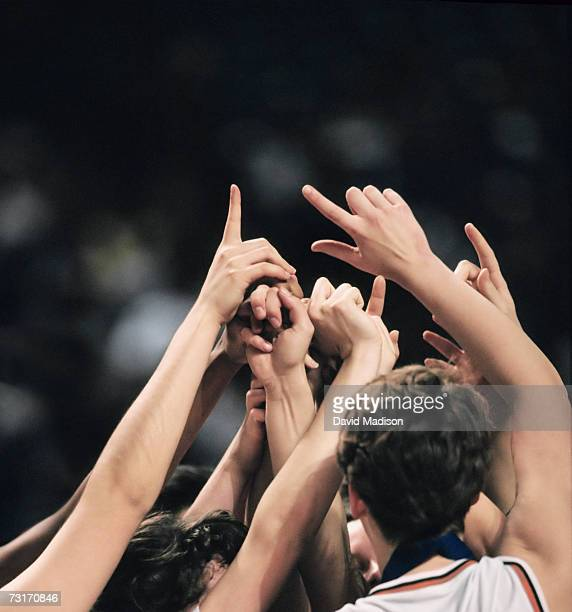female basketball team celebrating - women's basketball stock pictures, royalty-free photos & images
