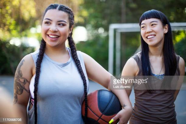 female basketball team on court - basketball sport stock pictures, royalty-free photos & images