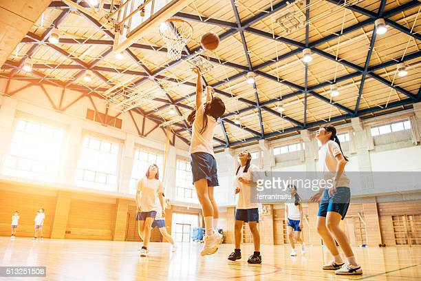 female basketball team playing in japanese high school - basketball sport stock pictures, royalty-free photos & images