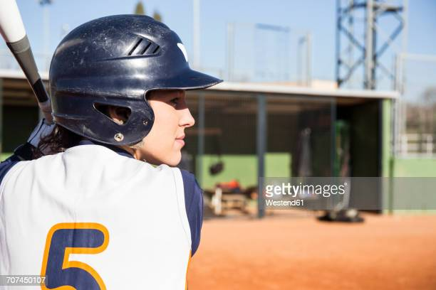 female batter ready to hit the ball during a baseball game - batting stock pictures, royalty-free photos & images