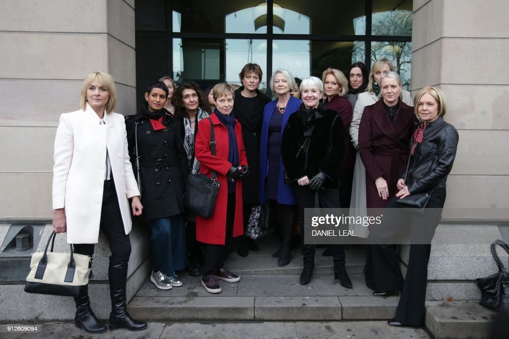 Female BBC employees including presenters Naga Munchetty (2L), Kate Silverton (C-L), Kate Adie (C-R) and Mariella Frostrup pose outside Portcullis house in London as Parliament prepares to question the BBC over its gender pay gap. / AFP PHOTO / Daniel LEAL