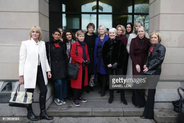 Female BBC employees including presenters Naga Munchetty Kate Silverton Kate Adie and Mariella Frostrup pose outside Portcullis house in London as...