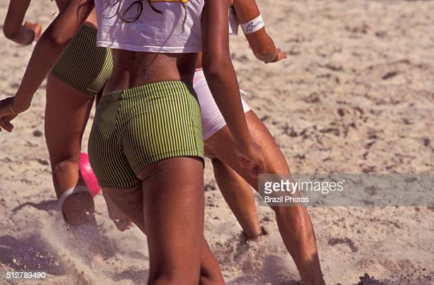 Female beach soccer the game emphasises skill and agility the irregularity of the softsand playing surface leads to a totally different style of play...
