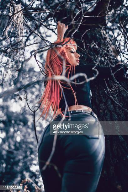 female beauty leaning on tree - white pants stock pictures, royalty-free photos & images