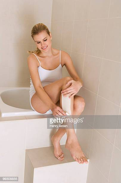 female beauty  waxing leg - one young woman only stock pictures, royalty-free photos & images